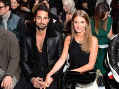 Hugo Taylor and Millie Mackintosh on the front row during the Blood Brother London Fashion Week Men's AW18 show held at BFC Show Space, London (Ian West/PA)