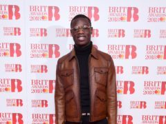 J Hus has been dropped from the bill (Ian West/PA)