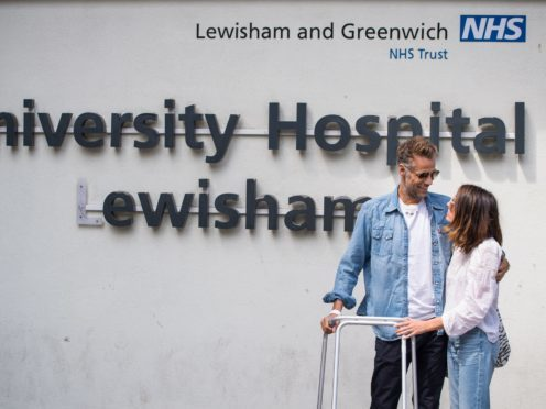 Former BBC TV Blue Peter presenter Richard Bacon leaves Lewisham Hospital in south east London with his wife Rebecca.