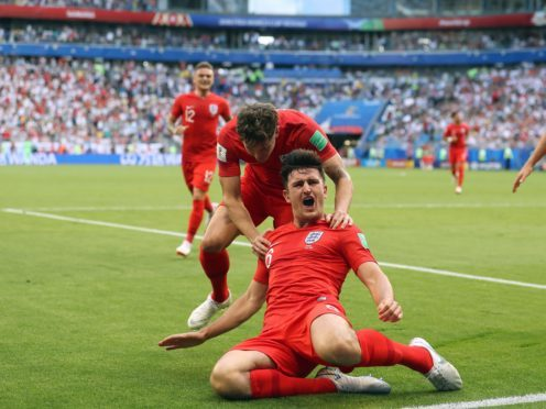 England's Harry Maguire celebrates scoring a goal at the 2018 World Cup – (Owen Humphreys/PA)