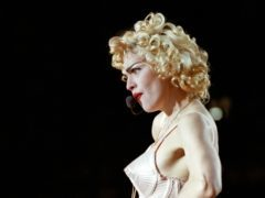 Pop singer Madonna performing to a crowd of 74,000 fans at Wembley Stadium, in London.