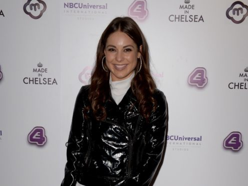 Louise Thompson has shared a picture of her engagement ring and fiance Ryan Libbey (Anthony Devlin/PA)