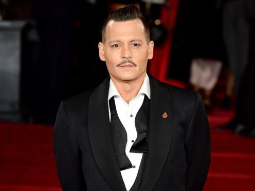 Johnny Depp was also involved in a legal wrangle with his former managers but settled in July (Ian West/PA)