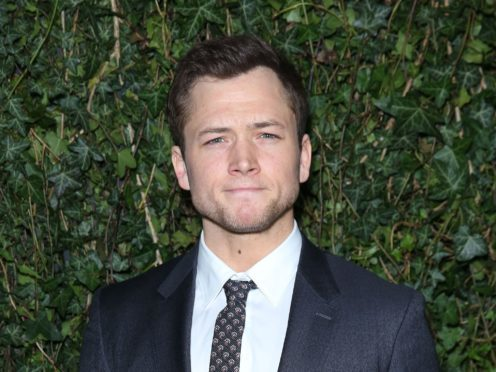 Taron Egerton has told fans his upcoming Robin Hood movie will be similar in tone to Peaky Blinders (Isabel Infantes/PA)