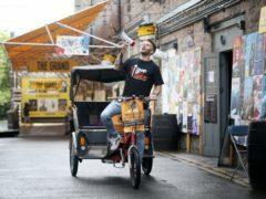 Comedian Joel Dommett sets off from the Pleasance Grand, Edinburgh, on a rickshaw to visit 100 shows at the Edinburgh Fringe Festival (Jane Barlow/PA)