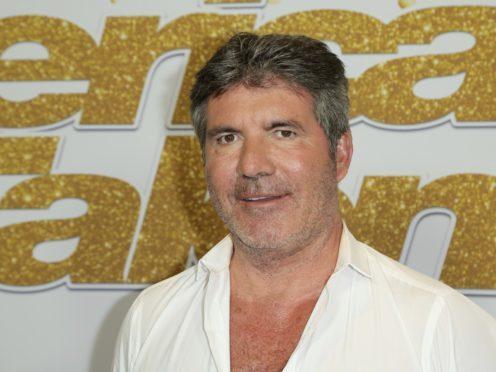 Simon Cowell alongside Kelly Clarkson (Richard Shotwell/Invision/AP)