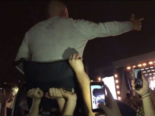 Liam Gallagher fans carried a man in a wheelchair above the crowd (@hannah_maex/PA)