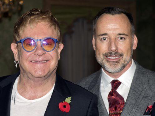 Sir Elton John and David Furnish accepted libel damages at London's High Court (Hannah McKay/PA)
