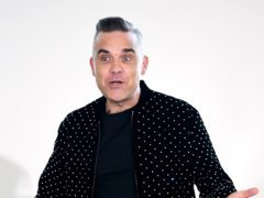 Robbie Williams was praised by X Factor host Dermot O'Leary (Ian West/PA)