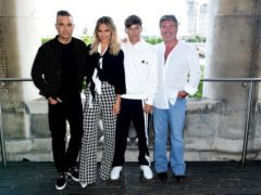 An X-Factor contestant passed his audition after singing Angels with Robbie Williams. (Ian West/PA)