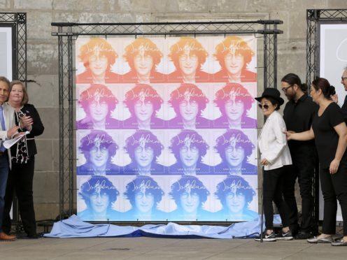 Yoko Ono unveils the John Lennon Commemorative Forever stamp (AP Photo/Stephen Groves)