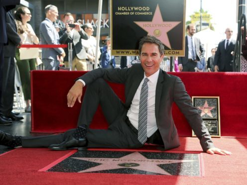 Will & Grace star Eric McCormack with his star (Willy Sanjuan/Invision/AP)