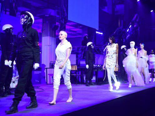 Rose McGowan and Winnie Harlow on the catwalk during the Nicholas Kirkwood London Fashion Week SS19 show (Ian West/PA)
