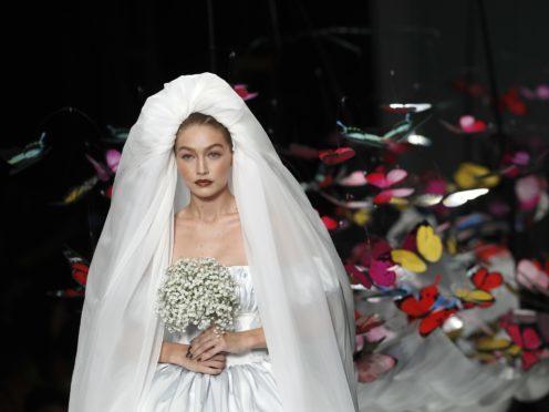 Gigi Hadid wears mini puffball wedding dress at star-studded Moschino show (Antonio Calanni/AP/PA)
