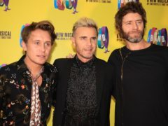 Mark Owen, Gary Barlow, and Howard Donald of Take That (PA)