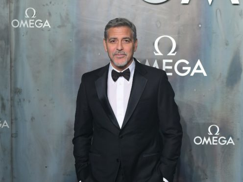 George Clooney dressed as a pilot for a party (Ian West/PA)