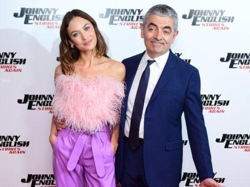 Olga Kurylenko and Rowan Atkinson attend the Johnny English Strikes Again premiere (Ian West/PA)