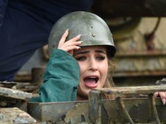 Love Island's Georgia Steel tries her hand at driving a tank (Joe Giddens/PA)