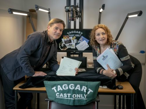Taggart stars Blythe Duff and John Michie hand over scripts and memorabilia from the famous police drama (GCU/PA)