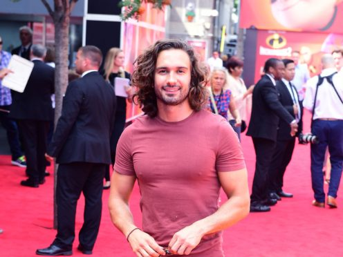 Personal trainer and TV star Joe Wicks is engaged to the mother of his child (Ian West/PA)