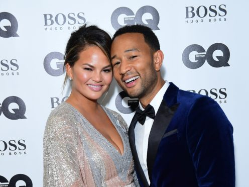 John Legend and Chrissy Teigen hosted a star-studded Christmas special (Ian West/PA)