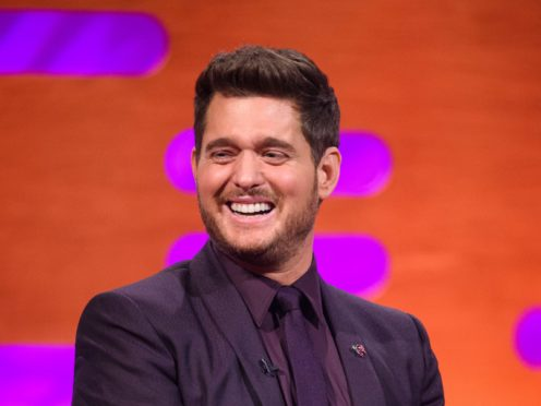 Michael Buble triumphed over Mumford & Sons to claim his fourth number one album (Matt Crossick/PA)