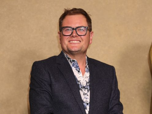Alan Carr says TV is a 'fantasy' that should not be taken so seriously politically. (Yui Mok/PA)