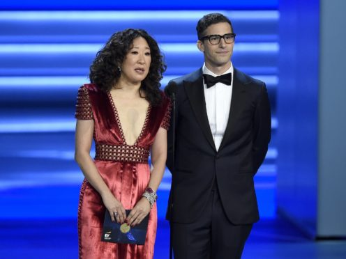 Sandra Oh and Andy Samberg present an award at the 70th Primetime Emmy Awards in Los Angeles (Chris Pizzello/Invision/AP)