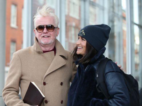 Chris Evans leaves the Virgin Radio studio with his wife Natasha (Yui Mok/PA)