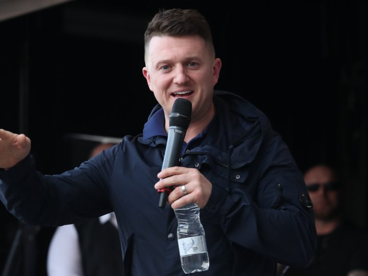 Former English Defence League leader Tommy Robinson as he addresses a protest over the BBC's Panorama programme outside the BBC in MediaCityUK, Salford.