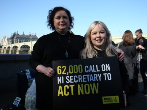 Derry Girls cast members Siobhan McSweeney and Nicola Coughlan, right, join MPs and women impacted by Northern Ireland's strict abortion laws on Westminster Bridge in London to demand legislative change (Jonathan Brady/PA)