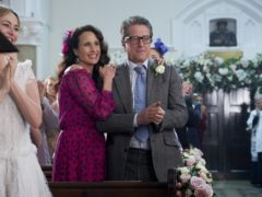 Andie Macdowell and Hugh Grant during the filming of of One Red Nose Day and a Wedding, one off special film that will premiere exclusively during Red Nose Day. (Comic Relief)