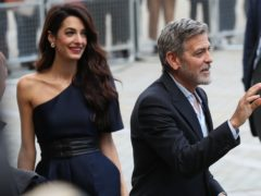 George and Amal Clooney were representing the Clooney Foundation for Justice (Andrew Milligan/PA)