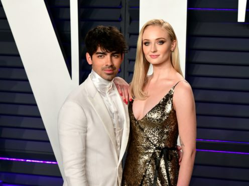 Game Of Thrones star Sophie Turner has revealed fiance Joe Jonas knows how the highly anticipated series ends (Ian West/PA)