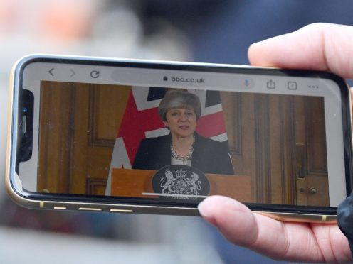 A journalist in Downing Street, London watches Prime Minister Theresa May making a statement following a cabinet meeting. (Victoria Jones/PA)