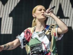 Rapper Iggy Azalea has vowed to take legal action after topless pictures taken for a magazine photoshoot were leaked online (Ben Birchall/PA)