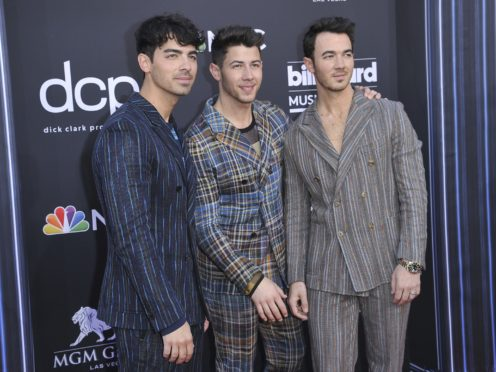 Joe Jonas, from left, Nick Jonas, and Kevin Jonas, of Jonas Brothers, arrive at the Billboard Music Awards (Richard Shotwell/Invision/AP)