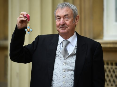 Pink Floyd drummer Nick Mason with his CBE for services to music (Kirsty O'Connor/PA)