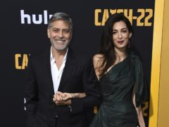 George and Amal Clooney arrive at the Los Angeles premiere of Catch-22 (Jordan Strauss/Invision/AP)