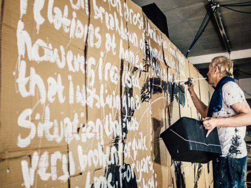Underworld's Karl Hyde and the Manchester Street Poem artwork (Tarnish Vision/PA)