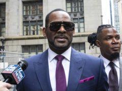 Musician R Kelly, centre, arriving for a court hearing (Ashlee Rezin/Chicago Sun-Times via AP)