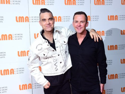 Robbie Williams and Scott Mills at a press conference with X Factor's LMA Choir at White City House, London (Ian West/PA)