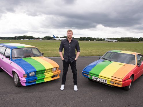 Freddie Flintoff with the rainbow cars that Top Gear will feature in an upcoming episode where the show went to Borneo and Brunei. (Jeff Spicer/BBC)