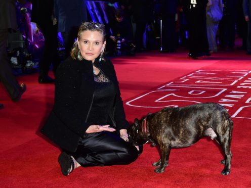 Carrie Fisher and dog Gary (Ian West/PA)