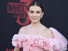 Stranger Things season three, starring Millie Bobby Brown, has achieved a record-breaking start on Netflix (Jordan Strauss/Invision/AP)