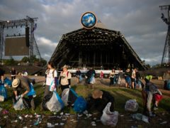 The clean-up begins in front of the Pyramid Stage (Aaron Chown/PA)
