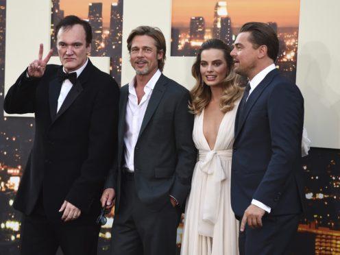 Quentin Tarantino poses with cast members Brad Pitt, Margot Robbie and Leonardo DiCaprio (Jordan Strauss/AP)