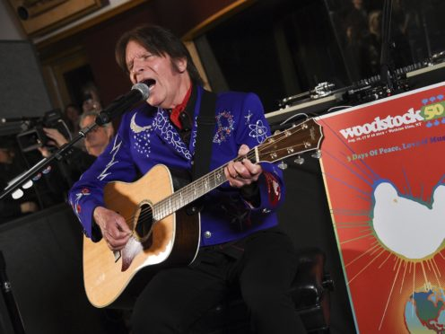 File photo of John Fogerty performing at the Woodstock 50 lineup announcement at Electric Lady Studios in New York (Evan Agostini/AP)