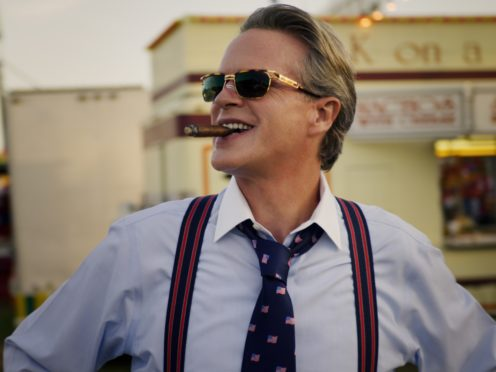 Stranger Things star Cary Elwes' character smokes on screen, a practice Netflix has vowed to cut back on (Netflix/PA)