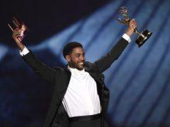 """When They See Us star Jharrel Jerome paid tribute to the """"exonerated five"""" as he won his first Emmy Award (Phil McCarten/Invision for the Television Academy/AP Images)"""
